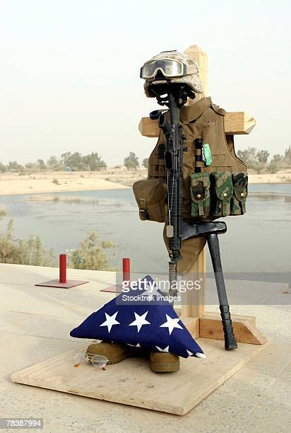 a fallen soldiers memorial. - boots rifle helmet stock pictures, royalty-free photos & images