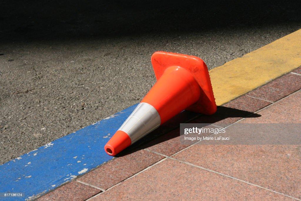 Fallen traffic cone on street : Stock-Foto