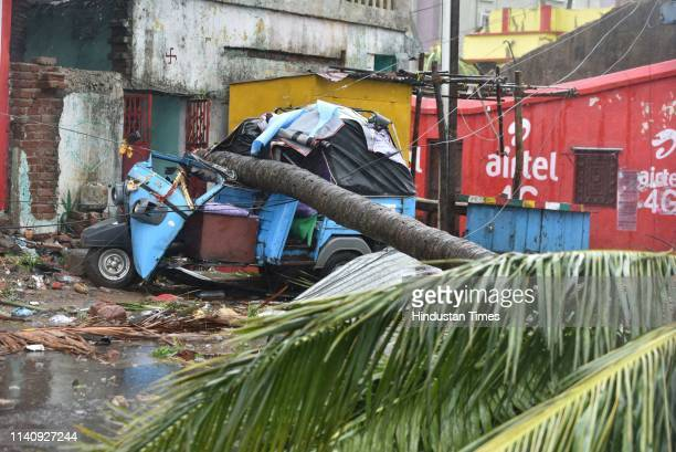 A fallen tree and damaged vehicle seen after the onset of cyclone Fani on May 3 2019 in Puri India Cyclone Fani on Friday lashed Odisha triggering...