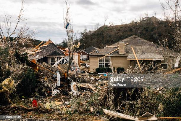 Fallen trees damage a property in the wake of a tornado on January 26, 2021 in Fultondale, Alabama. A tornado ripped through Fultondale damaging...