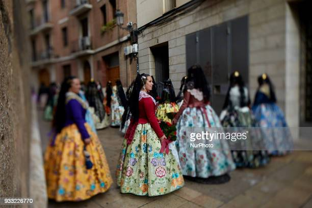 the image has been taken with a tiltshift lens Falleras dressed up in traditional costume prepare to present flowers to Saint Mary during Las Fallas...