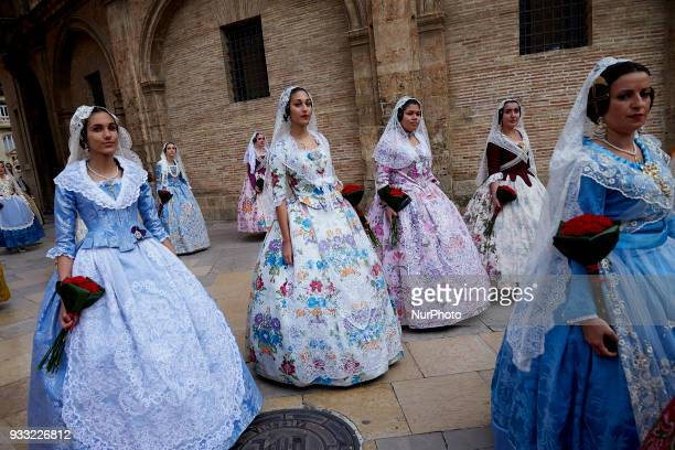 Falleras dressed up in traditional costume prepare to present flowers to Saint Mary during Las Fallas Festival on March 17 2018 in Valencia Spain The...