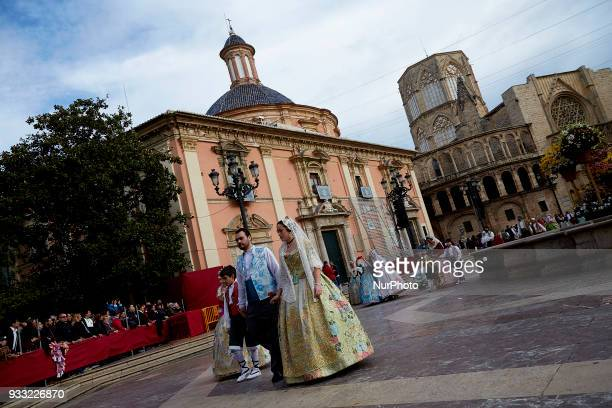 Falleros dressed up in traditional costume prepare to present flowers to Saint Mary during Las Fallas Festival on March 17 2018 in Valencia Spain The...