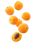 Falling apricot isolated on white background, clipping path, full depth of field
