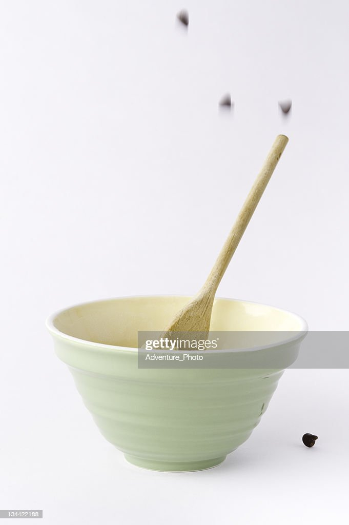 Falling Chocolate Chips and Mixing Bowl Ingredients : Stock Photo