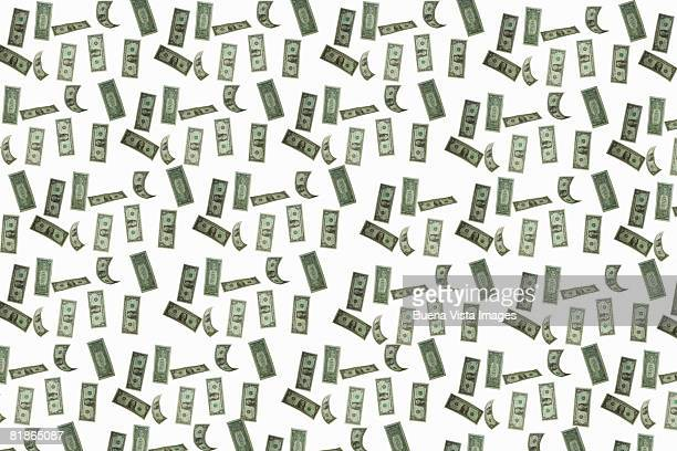 falling dollars. - money texture stock photos and pictures