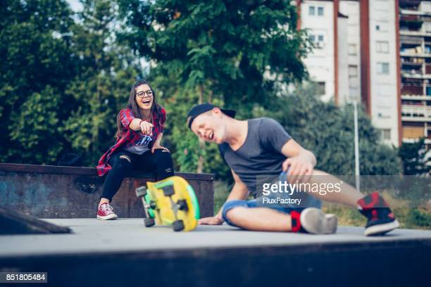 falling down - sneering stock pictures, royalty-free photos & images