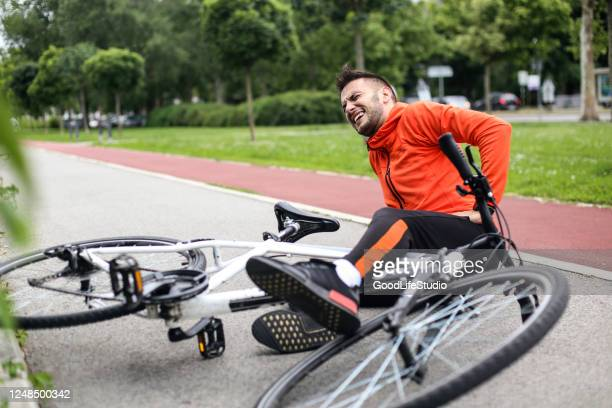 falling from a bicycle - crash stock pictures, royalty-free photos & images