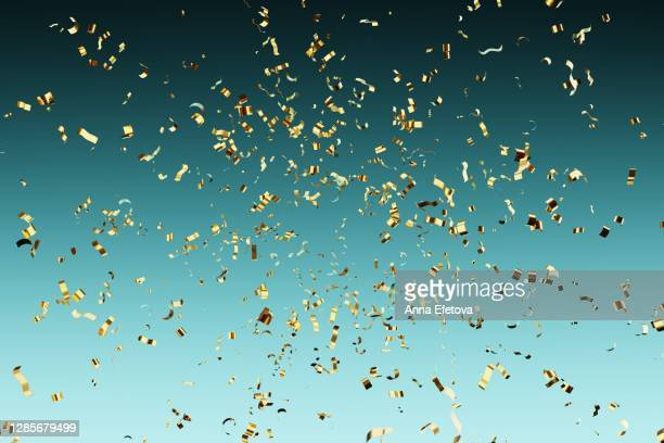 falling golden confetti. new year party concept - confetti stock pictures, royalty-free photos & images