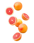 Falling grapefruits isolated on white background, clipping path, full depth of field