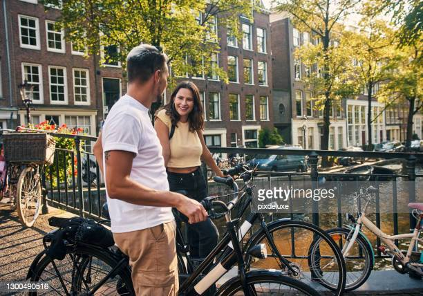 falling in love is a fun adventure - amsterdam stock pictures, royalty-free photos & images
