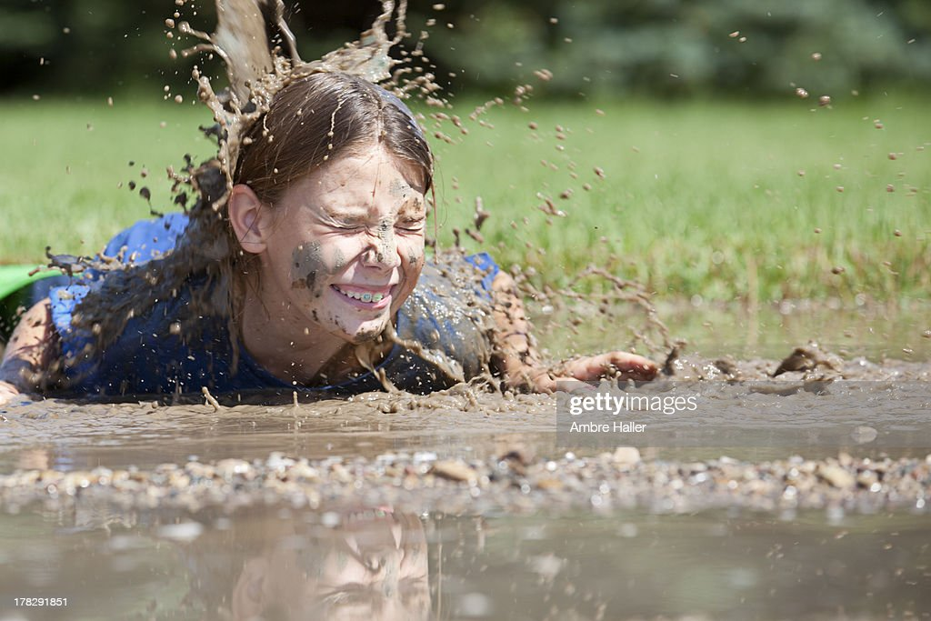 Falling into a mud puddle : Stock Photo