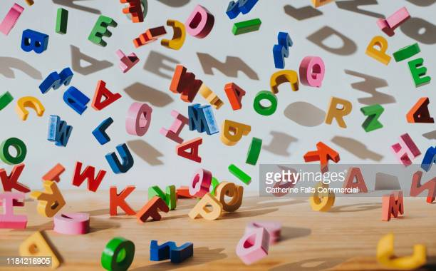 falling letters - studying stock pictures, royalty-free photos & images