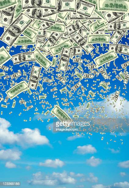 falling money over clear sky