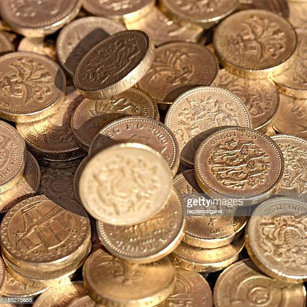 Falling one pound coins