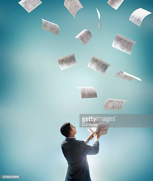 Falling Paper from the Sky Is Collected by a Man with a File Folder