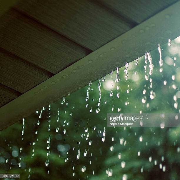 falling rain - eaves stock photos and pictures