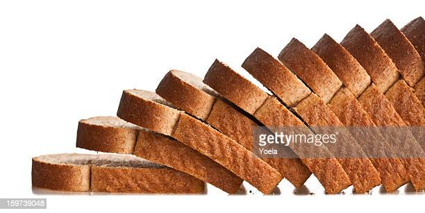 falling sliced bread - loaf of bread stock pictures, royalty-free photos & images