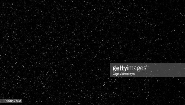 falling snow on black background - particle stock pictures, royalty-free photos & images