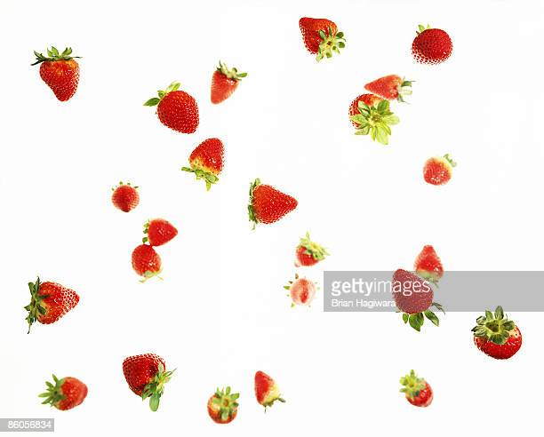 falling strawberries - strawberry stock pictures, royalty-free photos & images
