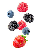 Falling wild berries mix, strawberry, raspberry, blueberry, blackberry, isolated on white background, clipping path, full depth of field