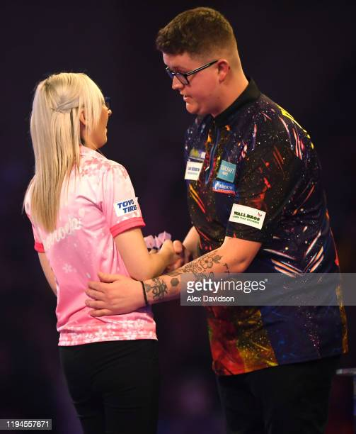 Fallon Sherrock embraces Ted Evetts after victory to become the first female to win a game in the PDC World Championships during Day 5 of the 2020...