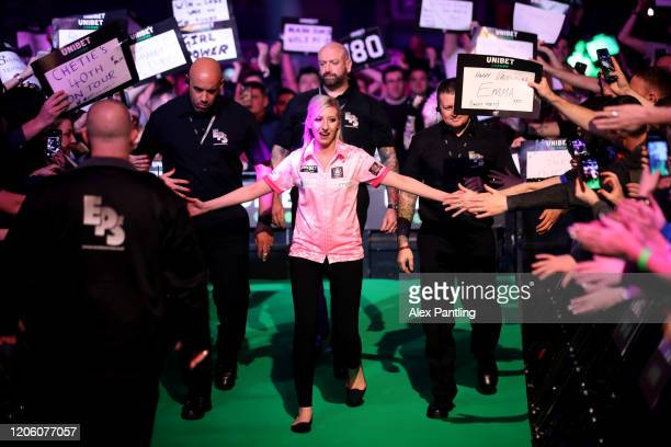 Fallon Sherrock enters the arena prior to her match against Glen Durrant during day two of the Unibet Premier League at Motorpoint Arena on February...
