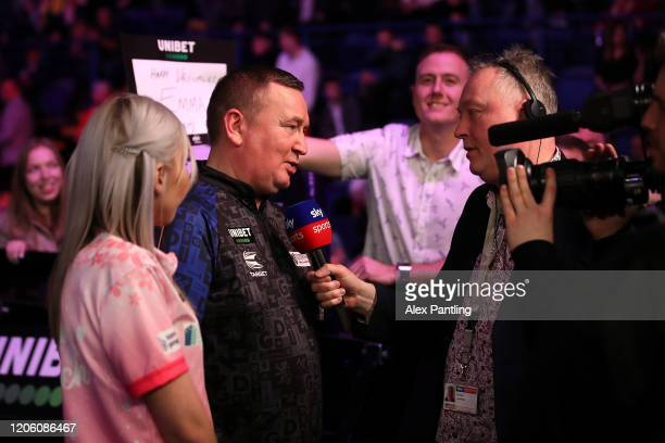Fallon Sherrock is interviewed with opponent Glenn Durrant following their draw during day two of the Unibet Premier League at Motorpoint Arena on...