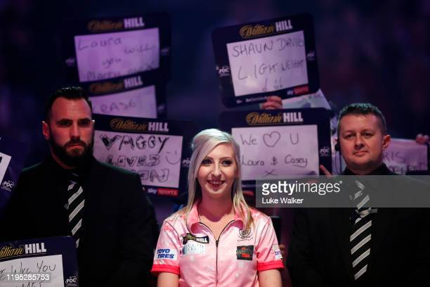 Fallon Sherrock looks on during the round 2 match between Mensur Suljovic and Fallon Sherrock on Day 9 of the 2020 William Hill World Darts...