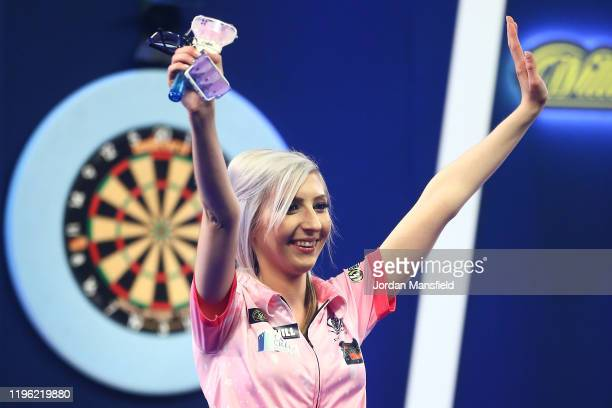 Fallon Sherrock of England acknowledges the crowd after defeat in her third round match against Chris Dobey of England on Day 12 of the 2020 William...