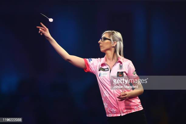 Fallon Sherrock of England throws during her third round match against Chris Dobey of England on Day 12 of the 2020 William Hill World Darts...