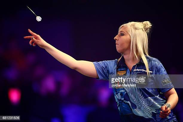 Fallon Sherrock of England throws during her Women's First Round match against Olive Byamukama of Scotland on Day Two of the BDO Lakeside World...