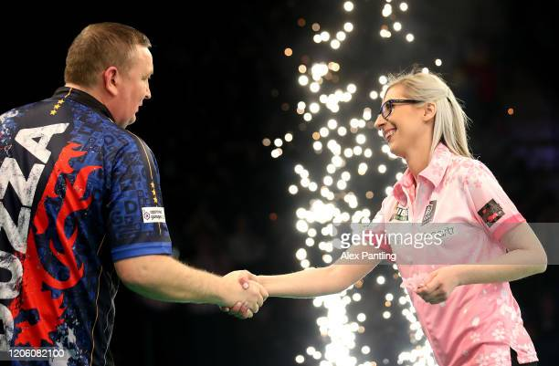 Fallon Sherrock shakes hands with opponent Glenn Durrant following their draw during day two of the Unibet Premier League at Motorpoint Arena on...