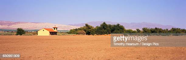 a fallow field lies in the foreground with a country church, green fields and mountains beyond, santa ynez valley - timothy hearsum stock pictures, royalty-free photos & images