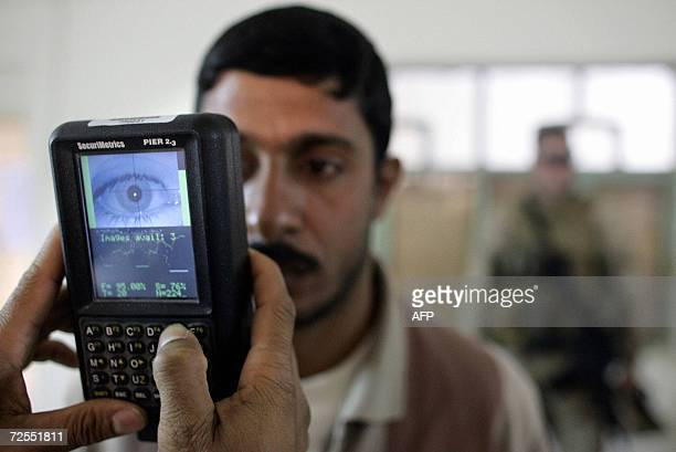 A US Marine takes a retinal scan of a local Fallujah resident at coalition badging office in the restive city of Fallujah 14 November 2006 Two years...
