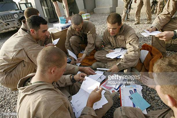 US marines sort through their mail at their miltary camp in Fallujah 50kms west of Baghdad 25 May 2007 US President George W Bush will sign a key...