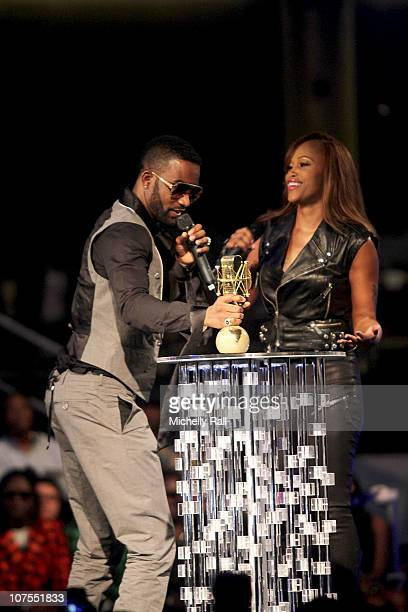 Fally Ipupa accepts the MAMA Trophy from EVE for Best Video at the EKO Expo Centre at the MTV Africa Music Awards 2010 with Airtel on December 11...