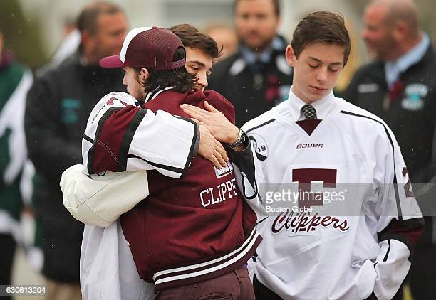 Falmouth High School hockey players embrace in front of the St Patrick Church in Falmouth Mass before James Lavin's funeral on Dec 27 2016 Lavin and...