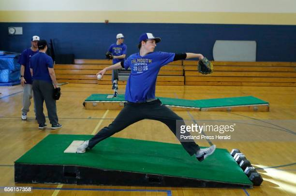Falmouth High School pitcher Max Fortier winds up for a pitch during their first practice of the season Monday March 20 2017 in Falmouth Maine