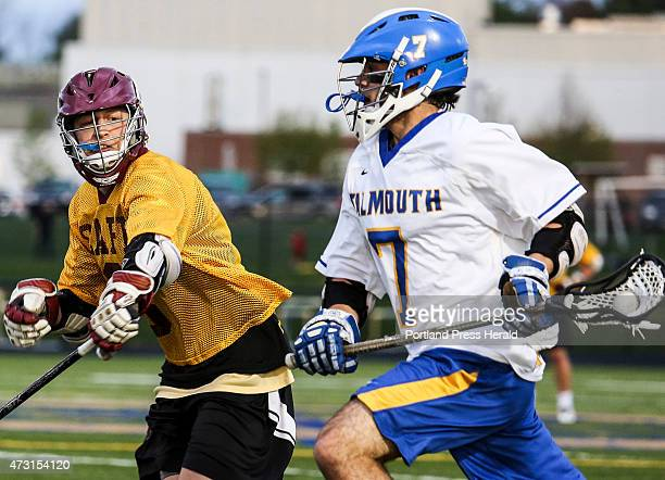 Falmouth player George Gilbert moves toward Cape Elizabeth's goal while Cole Caswell defends at Falmouth High School in Falmouth, ME on Tuesday, May...