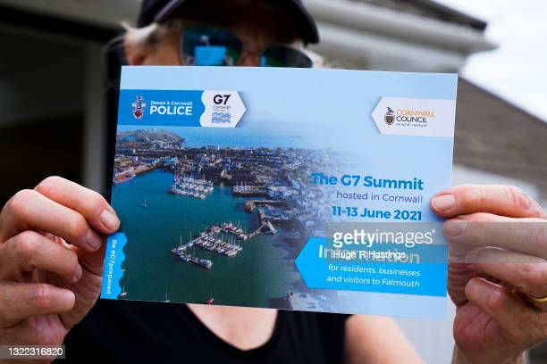 Falmouth resident holds up an information booklet produced by Devon & Cornwall Police and Cornwall Council that provides guidelines for residents and...