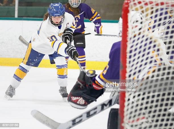 Falmouth vs Cheverus/Old Orchard Beach/Kennebunk girl's hockey Devon Sarazin of Falmouth watches her shot go past the glove of Cheverus goalie Anna...
