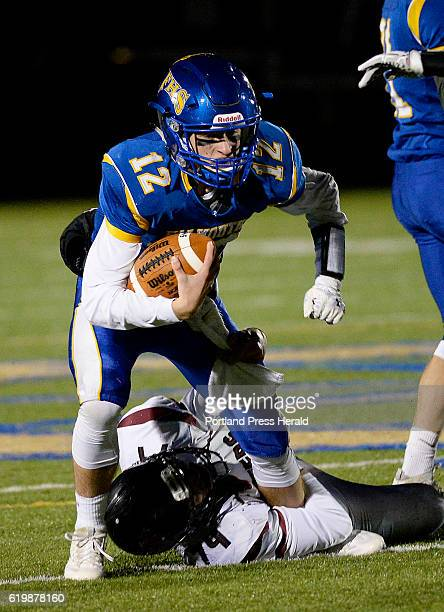 Falmouth's Jack Bryant tries to pick up extra yardage as Greely's Paul Buchanan gets a hold of him Friday October 28 2016