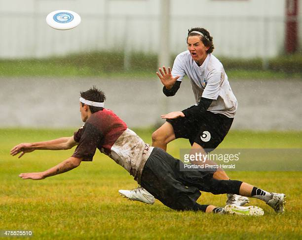 Falmouthss Charlie Hepburn waits to catch the frisbee against a diving Cape Elizabeth Ben Ekedahl during the coed high school Ultimate frisbee...