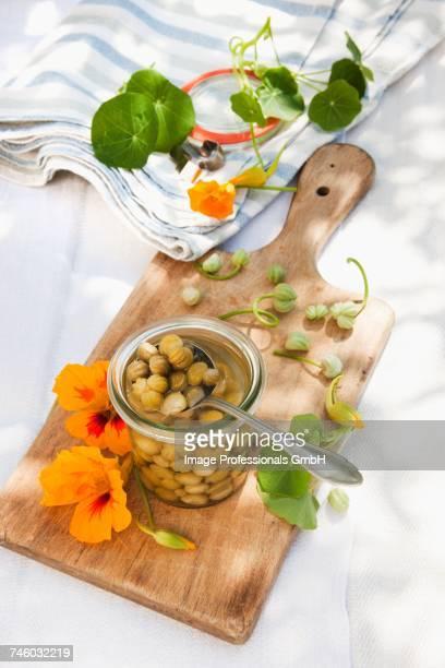 false capers made from nasturtium seeds - nasturtium stock pictures, royalty-free photos & images