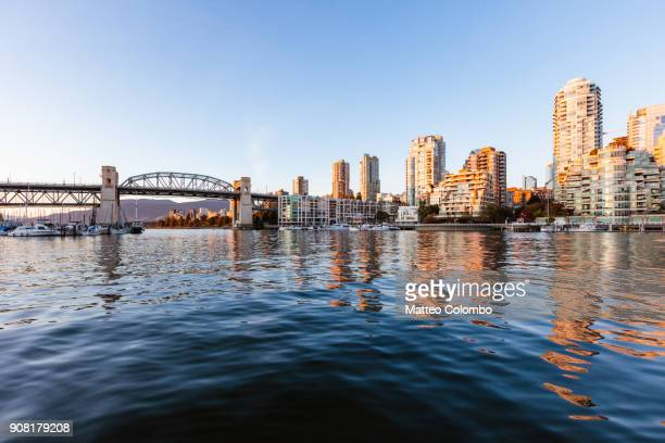 false creek at sunset, vancouver, british columbia, canada - vancouver canada stock pictures, royalty-free photos & images