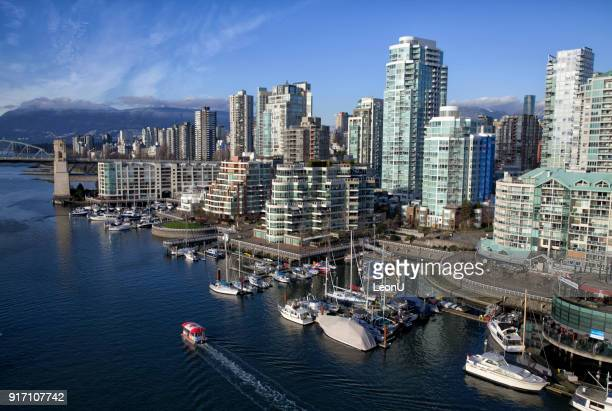 false creek in winter, vancouver, canada - vancouver stock pictures, royalty-free photos & images