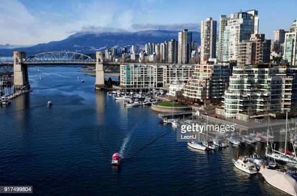false creek in winter, vancouver, canada - vancouver canada stock pictures, royalty-free photos & images