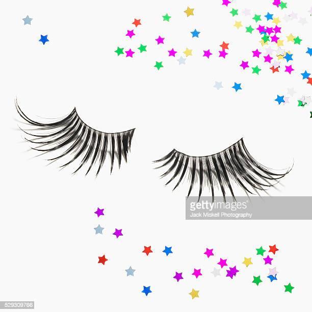 false eyelashes and confetti - つけまつげ ストックフォトと画像
