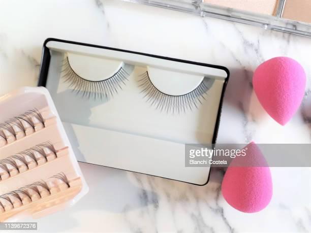 false eyelashes and make-up on marble background - false eyelash stock pictures, royalty-free photos & images